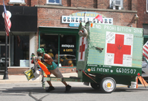 The walking veteran pulls his home on a cart behind him as he moved through Blissfield Sept. 20.