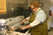 Liz Seeburger prepares bacon for the first Lenten Breakfast of the year in Blissfield. (Copyright 2016, River Raisin Publications, Inc.)