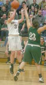 Kendall Hudson goes up over a Sand Creek defender in districts at Sand Creek. Copyright River Raisin Publications, Inc.